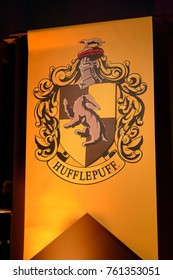 MADRID, SPAIN - NOV 22, 2017: Hufflepuff faculty logo, Wizarding world of Harry Poter experience in Madrid, Spain