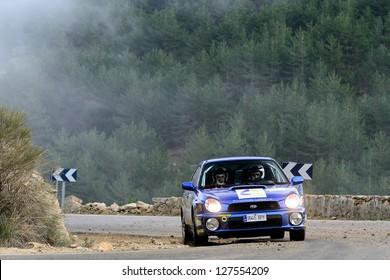 MADRID, SPAIN - NOV 28 : Spanish driver Antonio Garcia and his codriver Ignacio Aracil in a Subaru Impreza WRX STi races in Rally Comunidad de Madrid, on Nov 28, 2012 in Madrid, Spain