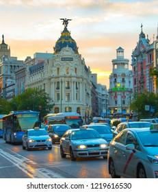 MADRID, SPAIN - NOVEMBER 07, 2016: Traffic on Madrid city center road at sunset. Madrid is the capital of Spain.