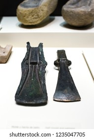 Madrid, Spain - November 11, 2017: Half mould and palstave of Late Bronce Age Axe. Selective focus. National Archeological  Museum of Madrid