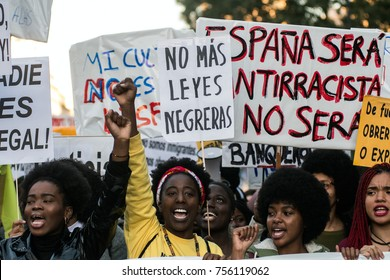 MADRID, SPAIN - NOVEMBER 12, 2017. Women protesting against racism shouting slogans against xenophobia and EU policies with refugees and migrants, in Madrid, Spain.