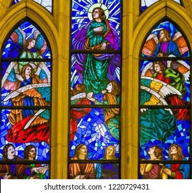 Madrid, Spain - November 13, 2015: Stained Glass depicting Saint John the Evangelist surrounded by angels in the Almudena Cathedral of Madrid, Spain.