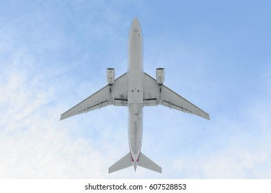 MADRID, SPAIN - NOVEMBER 14th 2015: Bottom view of a fully white plane, of an unrecognized commercial airline, when it's taking off from Madrid - Barajas, Adolfo Suarez airport, on November 14th 2015.