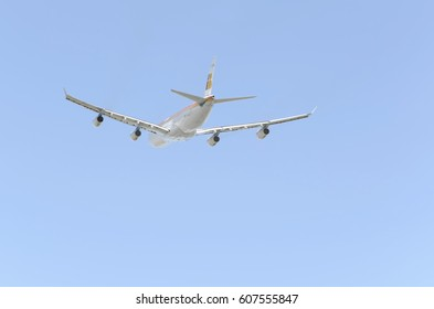 MADRID, SPAIN - NOVEMBER 14th 2015: Aerial back view of plane Airbus A340,of Iberia airline, when it's taking off from Madrid - Barajas, Adolfo Suarez airport,on November 14th 2015.4 engines. Blue sky