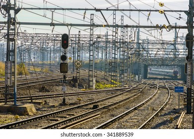 Madrid, Spain - November 19, 2015: A train comes closer Atocha's station in Madrid, between a forest of posts and cables