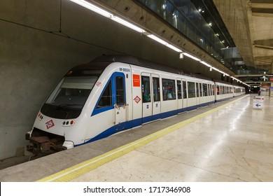 Madrid, Spain – November 21, 2019: Metro train at Madrid Barajas Airport Terminal 4 (MAD) in Spain.