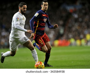 MADRID, SPAIN - November 21st, 2015 :  ISCO of REAL MADRID and BUSQUETS of BARCELONA FC in action running with the ball during La Liga match  at Santiago Bernabeu Stadium