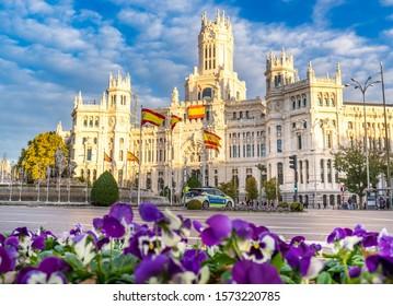 MADRID, SPAIN - November 22, 2019: Cybele Palace (Palacio de Cibeles) and Cibeles fountain in Madrid at golden hour