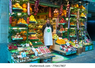Madrid, Spain - november 23, 2017: Shopkeeper at the door of his fruit and vegetable store, in the center of the city