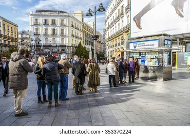 MADRID, SPAIN - November 26, 2015: typical Christmas queues to buy national lottery in the famous Puerta del Sol in Madrid, Spain