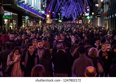 MADRID, SPAIN - NOVEMBER 30, 2018: Preciados street in Madrid. People doing their Christmas shopping. This is the most commercial street in the Spain capital.