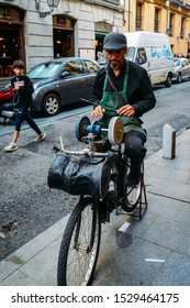 Madrid, Spain - Oct 13, 2019: Man sharpens knives using a bicycle on a street in Madrid, Spain