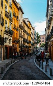 Madrid, Spain - Oct 13, 2019: Narrow street in the Latina neighbourhood of Madrid, Spain