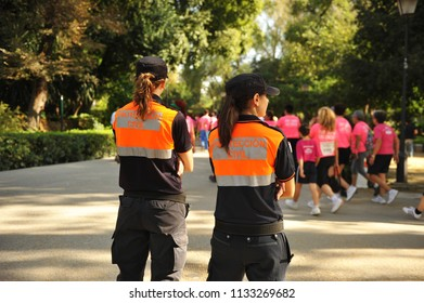 Madrid, Spain - Oct 5, 2015: Two vigilant Civil Protection (Protección Civil) women during a popular race, Spain