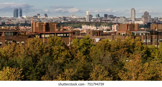 MADRID, SPAIN - OCTOBER 13, 2017: Bridge over the river Manzanares, appreciating in the background the Cathedral and the Royal palace with the air contaminated, OCT 13, 2017 in Madrid, Spain