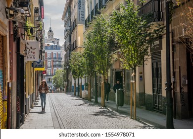 Madrid /Spain - October 15, 2019: A stylish young woman explores the  beautiful back streets of the popular Chueca neighborhood in central Madrid.