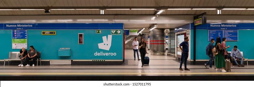 MADRID, SPAIN - OCTOBER 2019: Platform with passengers at Nuevos Ministerios metro station.