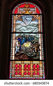 MADRID, SPAIN - OCTOBER 22, 2012: Our Lady of Guadaloupe stained glass art in Saint Jerome church (San Jeronimo el Real) in Madrid, Spain. The church dates back to 16th century.