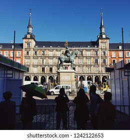 Madrid, Spain - October 23, 2017: Tourists sightseeing at the Plaza Mayor.