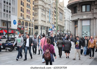 MADRID, SPAIN - OCTOBER 24, 2012: People shop downtown in Madrid. Madrid is a popular tourism destinations with 3.9 million estimated annual visitors (official data).
