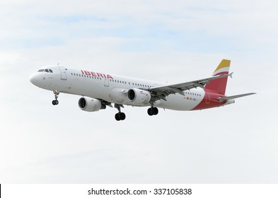 MADRID, SPAIN - OCTOBER 24th 2015: Aircraft -Airbus A321-211-, of -Iberia- airline, is landing on Madrid-Barajas -Adolfo Suarez- airport, on October 24th 2015. Cloudy day.
