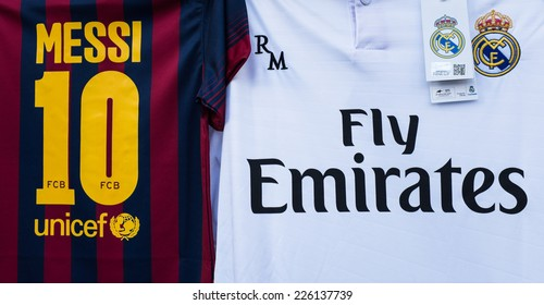 MADRID, SPAIN - OCTOBER 25, 2014: A couple of T-shirts for supporters of Real Madrid and Barcelona watching at Santiago Bernabeu Stadium while the Real Madrid-Barcelona match.