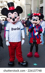 MADRID, SPAIN - OCTOBER 25, 2014: A couple of Mickey and Minnie Mouse with Real Madrid and Barcelona shirts, walking around Santiago Bernabeu Stadium at the Real Madrid-Barcelona match.