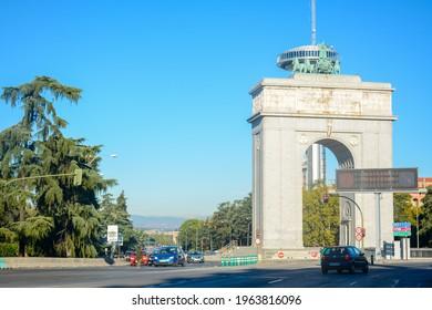 Madrid, Spain - October 25, 2020:  Triumphal arch Arco de la Victoria and Faro de Moncloa