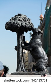 MADRID, SPAIN - october 31, 2013: Bear and the Madrono Tree Statue on the square Puerta del Sol in Madrid. It is the heraldic symbol of Madrid