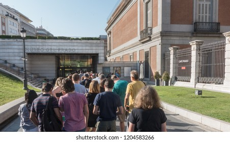 MADRID, SPAIN - SEPT. 12, 2018: Tourists with timed tickets await entrance to popular Prado Museum in Madrid. See Museo del Prado sign on building. The Prado. Advance tickets are recommended.