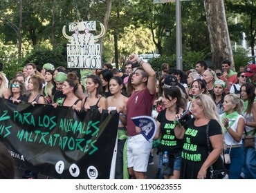 MADRID, SPAIN - SEPT 15, 2018: Marchers protest the killing of bulls in bullfights, and other animal abuse, demanding bullfighting in Spain be abolished.