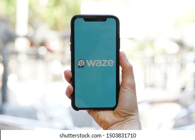 Madrid, Spain - September 14, 2019; Waze Iphone XS Application Screen Held by a Girls Hand on a Street