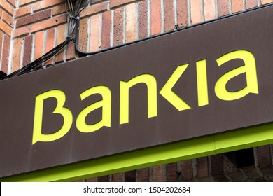 MADRID, SPAIN - SEPTEMBER 14, 2019. Bankia logo on Bankia bank branch office. Bankia is a Spanish bank that was formed consolidating the operations of seven regional savings banks