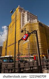 "MADRID / SPAIN - SEPTEMBER 23rd, 2008: Metro Entrance ""Plaza Espana"" in front of Edificio Espana under renovation"