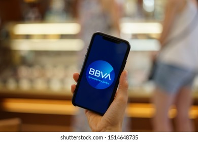 Madrid, Spain - September 26, 2019; BBVA Bank Iphone XS Application Held by a Girls Hand on a Bakery Shop