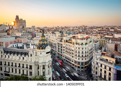 Madrid, Spain, sunset over landmark buildings on Gran Via street.