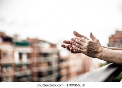 MADRID, Spain-04/20/2020- Woman applauds doctors from balcony of house in Madrid due to 2019-ncov