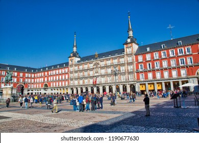 Madrid, Spain-16 September, 2017: Group of tourists visiting central Madrid Plaza, Plaza Mayor