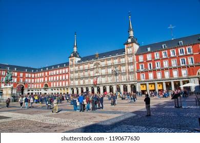 Madrid, Spain-16 September, 2017: Group of tourists visiting central Madrid Plaza, Plaza Mayor