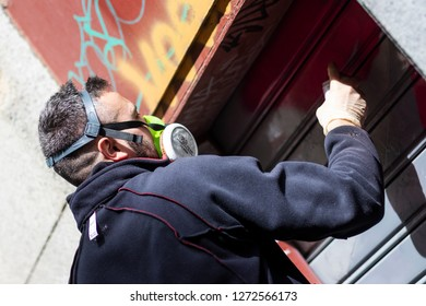 MADRID, SPAIN-APRIL 15, 2018: Celebration of Graffity party in the Malasaña neighborhood in Madrid. Participating artist painting a spray graffity on one of the authorized walls