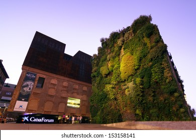 MADRID, SPAIN-AUGUST 31: Caixa Forum on August 31, 2013 Madrid. Caixa Forum Madrid is a museum and cultural center. It is sponsored by La Caixa. Facade of plants by botanist Patrick Blanc.