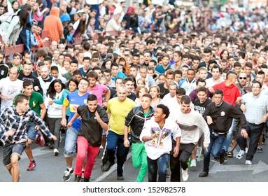 "MADRID SUBURB OF SAN SEBASTIAN DE LOS REYES - SEPT. 30, 2013: Start the race with bulls on street of San Sebastian de los Reyes during festival, Spain in 2013. Fiesta called ""little Pamplona"""