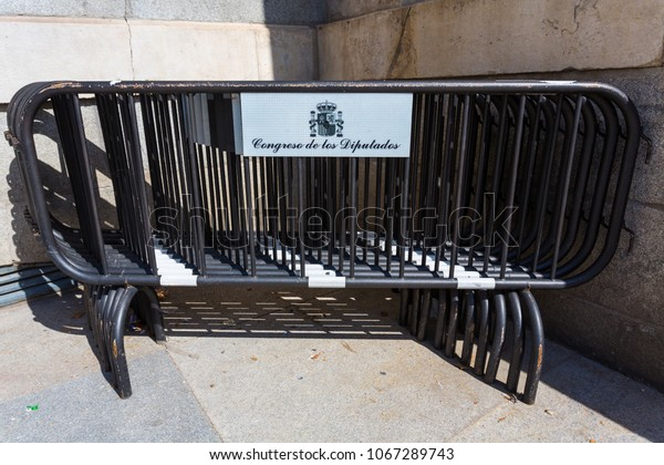 Madrid/Spain - March 13, 2015: In the front of the Congreso de los Diputados building (Congress of Deputies) sit several barricades not in use.