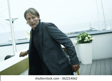 Mads Mikkelsen smokes cigarette at the Palais des Festivals third floor balcony during 65th Annual Cannes Film Festival at the on May 21, 2012 in Cannes, France.