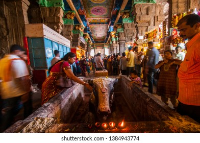MADURAI, INDIA 18 FEBRUARY 2017 : Blurred motions of unidentified people who visit inside the famous Meenakshi temple at Madurai,Tamil Nadu, India.