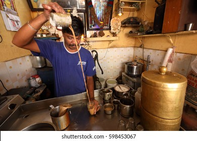 MADURAI - INDIA - JANUARY 18, 2017: Unidentified tea wallah preparing tea in a small traditional stall on January 18, 2017 in Madurai, India.