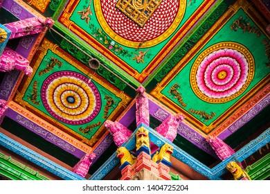 MADURAI, INDIA - MARCH 23, 2012: Ceiling pattern decor in the Meenakshi Amman Temple in Madurai in Tamil Nadu in India