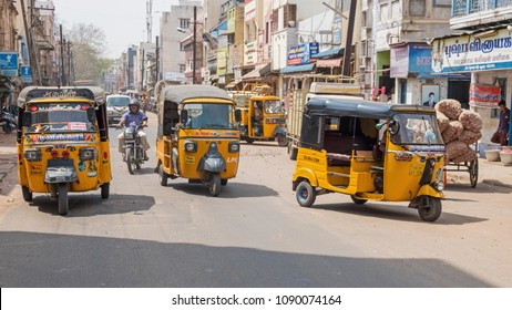 Madurai, India - March 9, 2018: Auto rickshaws dominating roadspace in the city centre. Such 'Tuk tuk' taxis are a feature of towns and cities across the Indian subcontinent