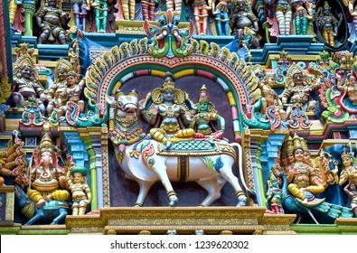 Madurai Tamil Nadu India August 24 2009  Stucco figures of shiva and parvati on the gopuram of sri meenakshi temple