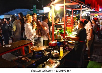 Mae Hong Son, THAILAND - 31 December 2018 : Walking street of Pai district on holiday There will be many tourists visiting the local food on the roadside.